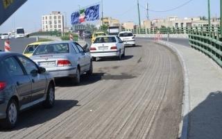 عملیات روکش آسفالت مکانیزه پل «سوم خرداد» آغاز شد